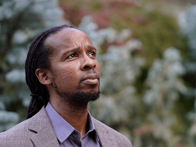 Ibram X. Kendi, director of Boston University's Center for Antiracist Research, stands for a portrait Wednesday, Oct. 21, 2020, in Boston. (AP Photo/Steven Senne)