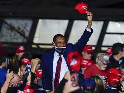 State Rep. Vernon Jones walks through the crowd before President Donald Trump arrives to speak at a campaign rally on Sunday, Nov. 1, 2020, at Richard B. Russell Airport in Rome, Ga. (AP Photo/Brynn Anderson)