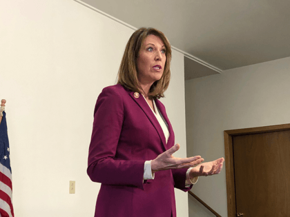 In this Saturday, Dec. 21, 2019, file photo, Rep. Cindy Axne, D-Iowa., speaks to constituents about her vote on the USMCA trade deal in Guthrie Center, Iowa. Axne is running for reelection on Nov. 3, 2020. (AP Photo/Alexandra Jaffe, File)