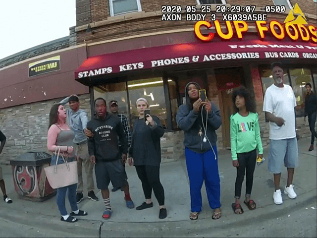 This May 25, 2020, file image from a police body camera shows Genevieve Hansen, fourth from right filming, Darnella Frazier, third from right filming, as former Minneapolis police officer Derek Chauvin was recorded pressing his knee on George Floyd's neck for several minutes in Minneapolis.
