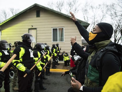 Protestors and Police Officers clash outside the Brooklyn Center Police Department on April 12, 2021 in Brooklyn Center, Minnesota after the killing of Daunte Wright. Photo: Chris Tuite/ImageSPACE /MediaPunch /IPX