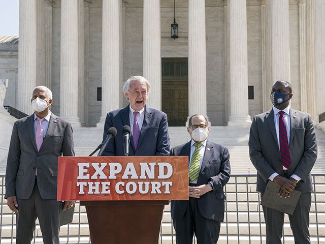 From left, Rep. Hank Johnson, D-Ga., Sen. Ed Markey, D-Mass., House Judiciary Committee Chairman Jerrold Nadler, D-N.Y., and Rep. Mondaire Jones, D-N.Y., hold a news conference outside the Supreme Court to announce legislation to expand the number of seats on the high court, on Capitol Hill in Washington, Thursday, April …