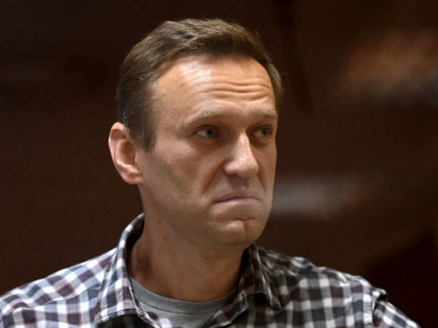 Russian opposition leader Alexei Navalny stands inside a glass cell during a court hearing at the Babushkinsky district court in Moscow on February 20, 2021. - The Kremlin's most prominent opponent Alexei Navalny faces two court decisions on Saturday that could seal a judge's ruling to jail him for several …