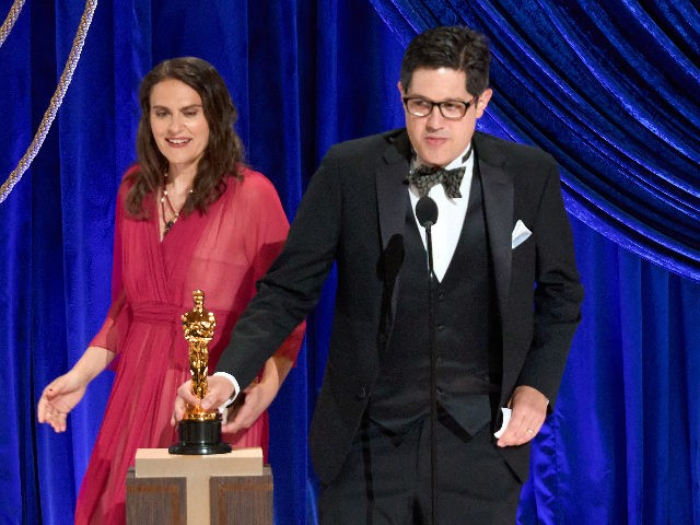 LOS ANGELES, CALIFORNIA – APRIL 25: (EDITORIAL USE ONLY) In this handout photo provided by A.M.P.A.S., (L-R) Alice Doyard and Anthony Giacchino accept the Documentary (Short Subject) award for 'Colette' onstage during the 93rd Annual Academy Awards at Union Station on April 25, 2021 in Los Angeles, California. (Photo by …