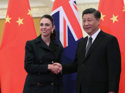 BEIJING, CHINA - APRIL 01: Chinese President Xi Jinping, right and New Zealand Prime Minister Jacinda Ardern, left shake hands before the meeting at the Great Hall of the People on April 1, 2019 in Beijing, China. (Kenzaburo Fukuhara - Pool/Getty Images)
