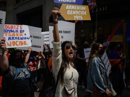 Members of New York's Armenian community hold placards and shout slogans as they march though Manhattan on the anniversary of the Armenian genocide, on April 24, 2021. - US President Joe Biden recognized the 1915 killings of Armenians by Ottoman forces as genocide, a watershed moment for descendants of the …
