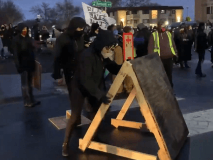 BLM protesters erect shields to protect from police projectiles (Twitter Video Screenshot/Nic Rowan/Washington Examiner)