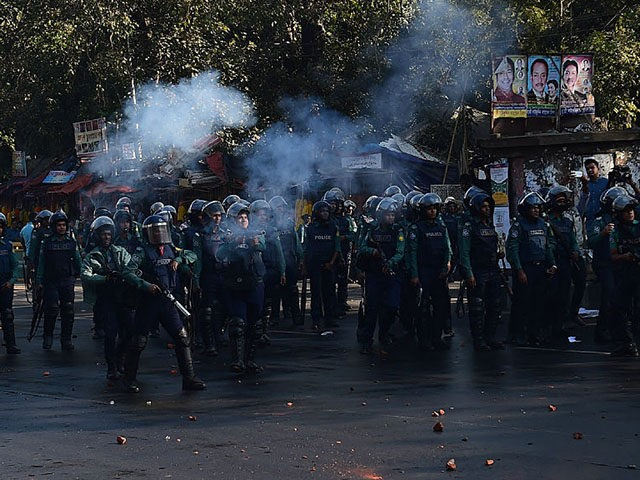 Bangladeshi police fire tear gas shells towards demonstrators during a strike to protest the construction of a coal-fired power plant in Dhaka on January 26, 2017. Clashes erupted in Bangladesh's capital January 26 as police fired tear gas at hundreds of campaigners protesting against a massive coal-fired power plant they …