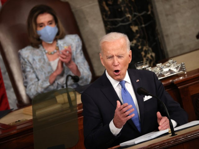 WASHINGTON, DC - APRIL 28: U.S. President Joe Biden addresses a joint session of congress as Speaker of the House U.S. Rep. Nancy Pelosi (D-CA) (L) looks on in the House chamber of the U.S. Capitol April 28, 2021 in Washington, DC. On the eve of his 100th day in …