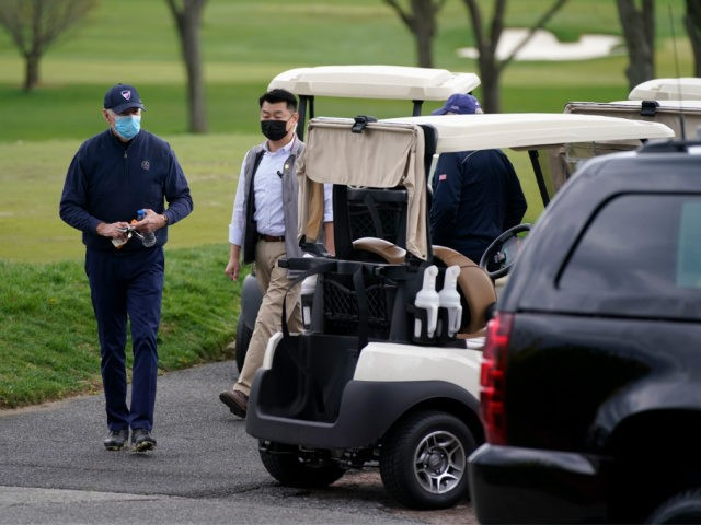 President Joe Biden walks to a motorcade vehicle after golfing at Wilmington Country Club, Saturday, April 17, 2021, in Wilmington, Del. Biden is spending the weekend at his home in Delaware. (AP Photo/Patrick Semansky)