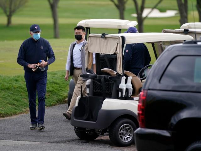 President Joe Biden walks to a motorcade vehicle after golfing at Wilmington Country Club, Saturday, April 17, 2021, in Wilmington, Del. Biden is spending the weekend at his home in Delaware. (AP Photo/Patrick Semansky)