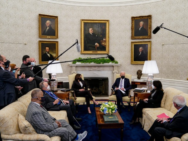 WASHINGTON, DC - APRIL 12: U.S. President Joe Biden and Vice President Kamala Harris meet with members of Congress, including Rep. Don Young (R-AK), Rep. Donald Payne Jr. (D-NJ), Sen. Roger Wicker (R-MS), Sen. Maria Cantwell (D-WA) and others in the Oval Office at the White House on April 12, …