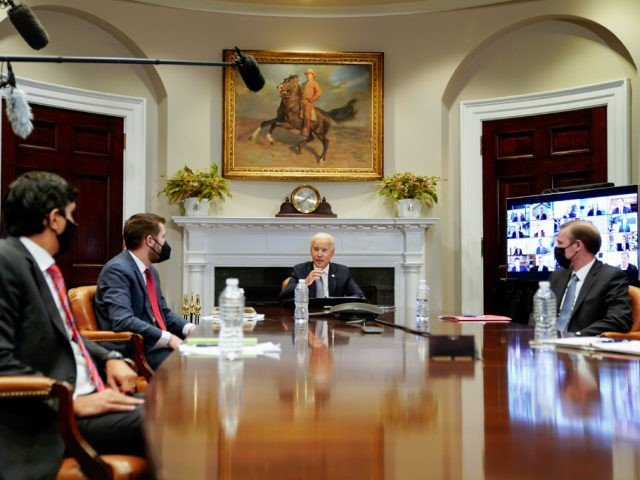 WASHINGTON, DC - APRIL 12: U.S. President Joe Biden (C) joins a CEO Summit on Semiconductor and Supply Chain Resilience via video conference with National Security Advisor Jake Sullivan (R), National Economic Council Director Brian Deese and others from the Roosevelt Room at the White House on April 12, 2021 …