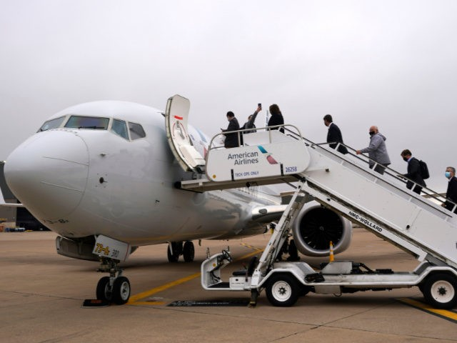 Invited passengers board an American Airlines Boeing 737 Max jet before departing from Dallas Fort Worth airport in Grapevine, Texas, Wednesday, Dec. 2, 2020. American Airlines took its long-grounded Boeing 737 Max jets out of storage, updating key flight-control software, and flying the planes in preparation for the first flights …