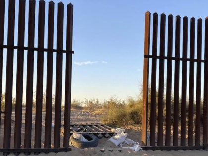 This photo provided by the US Customs and Border Protection shows a hole cut into Southern California's border fence with Mexico on Wednesday, March 3, 2021. Thirteen people killed in one of the deadliest border crashes on record were among more than 40 migrants who entered the U.S. through the …