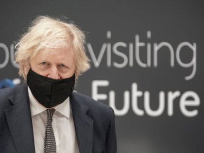 Britain's prime minister Boris Johnson wearing a mask because of the coronavirus pandemic visits BAE Systems at Warton Aerodrome in Preston, northwest England, on March 22, 2021. - The prime minister's visit comes to mark the publication of the UK government's Integrated Review, an overhaul of Britain's security, defence and …