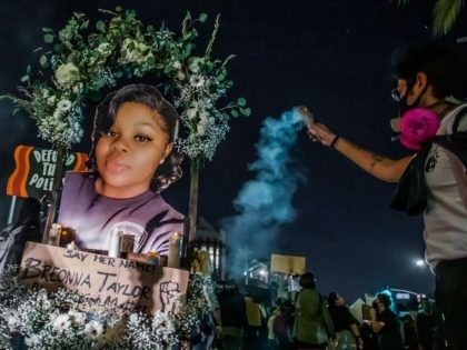Protesters march against police brutality in Los Angeles, on September 23, 2020, following a decision on the Breonna Taylor case in Louisville, Kentucky. - A judge announced charges brought by a grand jury against Detective Brett Hankison, one of three police officers involved in the fatal shooting of Taylor in …