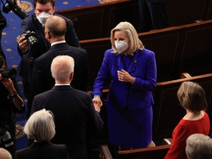 WASHINGTON, DC - APRIL 28: U.S. President Joe Biden greets Rep. Liz Cheney (R-WY) with a fist bump before addressing a joint session of congress in the House chamber of the U.S. Capitol April 28, 2021 in Washington, DC. On the eve of his 100th day in office, Biden spoke …