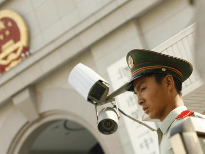 A Chinese paramilitary policeman stands guard outside Beijing's No. 2 Intermediate Court where Hong Kong reporter Ching Cheong was sentenced to five years in jail for espionage on behalf of Taiwan, 31 August 2006. The verdict on Ching, who worked for Singapore's Straits Times newspaper, was handed down after a …