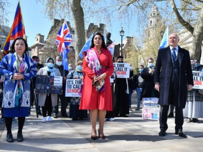 British Conservative Party MPs Nusrat Ghani (C) and Iain Duncan Smith (R) join members of the Uyghur community as they demonstrate to call on the British parliament to vote to recognise alleged persecution of China's Muslim minority Uyghur people as genocide and crimes against humanity in London on April 22, …