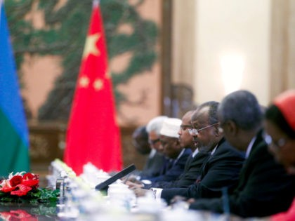 Djibouti's President Ismail Omar Guelleh, third from right, talks to Chinese counterpart Hu Jintao, unseen, following a welcoming ceremony at the Great Hall of the People in Beijing Wednesday, July 18, 2012. Guelleh is in Beijing to attend the opening ceremony of the fifth Ministerial Meeting of the Forum on …