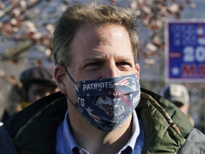 FILE— In this Nov. 3, 2020 file photograph, N.H. Gov. Chris Sununu wears a protective mask, due to the COVID-19 virus outbreak, at a polling station in Windham, N.H. New Hampshire on joined three dozen other states, including the rest of New England, in enacting a statewide mask mandate as …