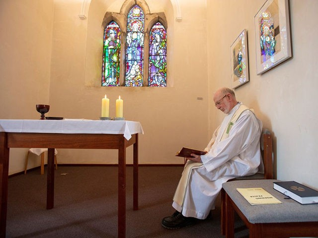 Prior of Lough Derg, Father Laurence (La) Flynn prays inside St Mary's Chapel at St. Patrick's Purgatory on Lough Derg, currently closed to visitors due to the COVID-19 pandemic, near Donegal in Ireland, on July 27, 2020. - As people in Ireland endured months of coronavirus lockdown limbo, priest Laurence …
