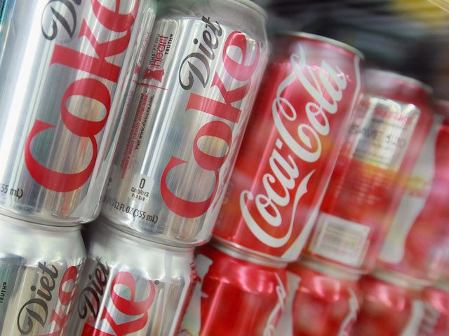 Cans of Sprite, Diet Coke and Coca-Cola are offered for sale at a grocery store on April 17, 2012 in Chicago, Illinois. The Coca-Cola Co. reported an 8 percent increase in net income for the first quarter of 2012 with global volume growth of 5%. (Photo by Scott Olson/Getty Images)