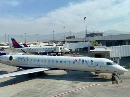 A Delta Airlines plane is seen at the gate at Salt Lake City International Airport (SLC), Utah, on October 5, 2020. (Photo by Daniel SLIM / AFP) (Photo by DANIEL SLIM/AFP via Getty Images)
