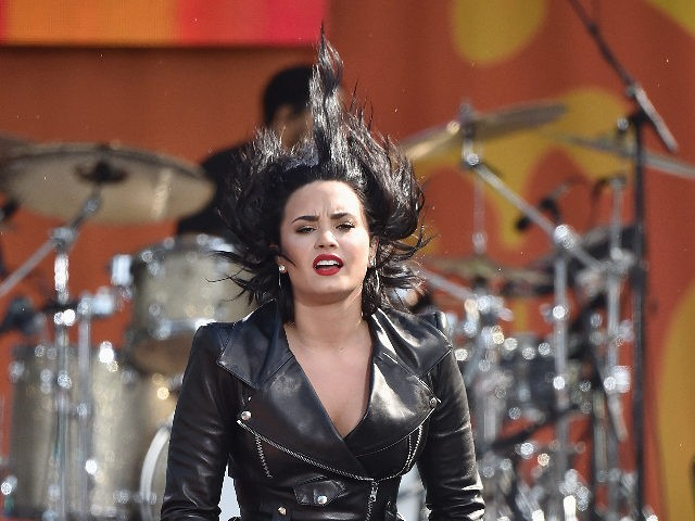 Demi Lovato Continues Attack On L.A. Frozen Yogurt Shop, Offers Branding Help So She Can 'Feel Safe Going in There'