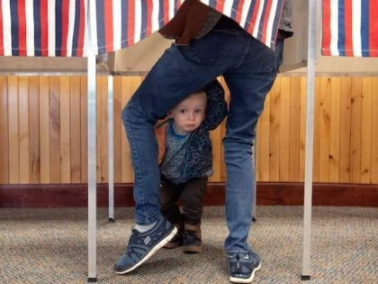 Two-year-old Noah Davenport of Granby, Colorado, waits for his mother to cast her ballot at the Granby Town Hall on November 3, 2020. - Americans were voting on Tuesday under the shadow of a surging coronavirus pandemic to decide whether to reelect Republican Donald Trump, one of the most polarizing …