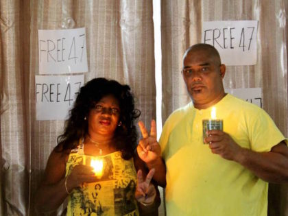 Berta Soler of the Ladies in White and former political prisoner Angel Moya conduct a home vigil in Cuba for 47 Hong Kong political prisoners, April 15, 2021