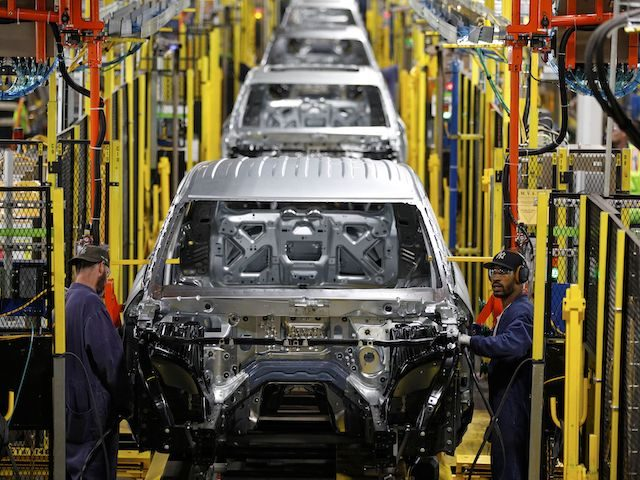 Workers assemble cars at the newly renovated Ford's Assembly Plant in Chicago, June 24, 2019. - The plant was revamped to build the Ford Explorer, Police Interceptor Utility and Lincoln Aviator. (Photo by JIM YOUNG / AFP) (Photo credit should read JIM YOUNG/AFP via Getty Images)