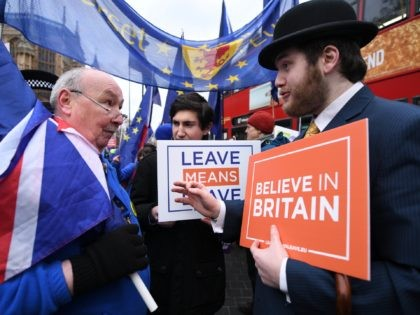 LONDON, ENGLAND - JANUARY 29: Pro-EU and pro-Brexit protestors discuss the vote and ongoing political processes as they demonstrate near to the Houses of Parliament on January 29, 2019 in London, England. Seven amendments to the Prime Minister's Brexit deal have been chosen for debate today including those from Dominic …