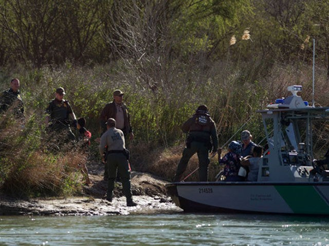 Central American migrants are taken into custody after being detained by members of the U.S. Border Patrol during their attempt to cross the Rio Bravo from Piedras Negras, in Coahuila state, Mexico to Eagle Pass, in Texas, as seen from Piedras Negras on February 17, 2019. - Last week Trump …