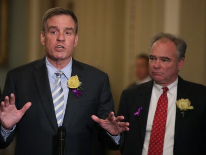 WASHINGTON, DC - JUNE 04: Sen. Mark Warner (D-VA) (L) and Sen. Tim Kaine (D-VA) speak about gun control and the recent Virginia Beach shooting after attending the Senate Democrats weekly policy luncheon on Capitol Hill June 4, 2019 in Washington, DC. (Photo by Mark Wilson/Getty Images)
