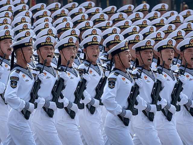 Chinese navy sailors march in formation during a parade to celebrate the 70th Anniversary of the founding of the People's Republic of China at Tiananmen Square in 1949, on October 1, 2019 in Beijing, China. (Photo by Kevin Frayer/Getty Images)