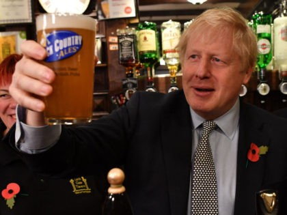 WOLVERHAMPTON, UNITED KINGDOM - NOVEMBER 11: British Prime Minister Boris Johnson raises a pint of beer as he campaigns ahead of the general election at the Lynch Gate Tavern on November 11, 2019 in Wolverhampton, United Kingdom. The U.K. will go to the polls in a general election on December …