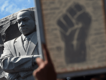 A statue of Martin Luther King Jr. is seen as demonstrators raise a fist image at The Martin Luther King Jr. Memorial to protest the death of George Floyd, who died in police custody in Minneapolis, in Washington, DC, on June 4, 2020. - On May 25, 2020, Floyd, a …