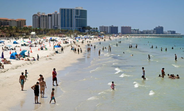 CLEARWATER, FL - MAY 04: People visit Clearwater Beach after Governor Ron DeSantis opened the beaches at 7am on May 04, 2020 in Clearwater, Florida. Restaurants, retailers, beaches and some state parks reopen today with caveats, as the state continues to ease restrictions put in place to contain COVID-19. (Photo …