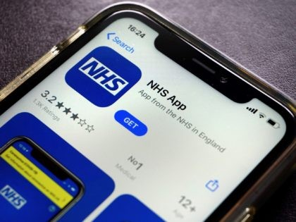 A photograph arranged as an illustration in Hartley Wintney, west of London on August 19, 2020 shows the NHS app, for Britain's NHS (National Health Service) on a smart phone. (Photo by ADRIAN DENNIS / AFP) (Photo by ADRIAN DENNIS/AFP via Getty Images)