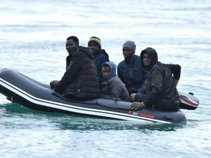 Migrants in a dinghy sail in the Channel toward the south coast of England on September 1, 2020 after crossing from France. - Migrant crossings of the Channel between France and England have hit record numbers, with thousands having arrived in small boats since the beginning of the year. The …