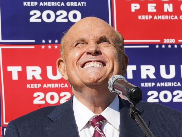 Attorney for the President, Rudy Giuliani, speaks at a news conference in the parking lot of a landscaping company on November 7, 2020 in Philadelphia. - Joe Biden has won the US presidency over Donald Trump, TV networks projected on November 7, 2020. CNN, NBC News and CBS News called …