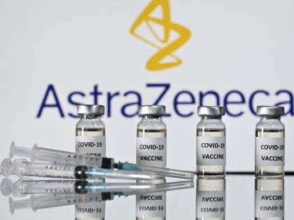 An illustration picture shows vials with Covid-19 Vaccine stickers attached and syringes with the logo of British pharmaceutical company AstraZeneca on November 17, 2020. (Photo by JUSTIN TALLIS / AFP) (Photo by JUSTIN TALLIS/AFP via Getty Images)