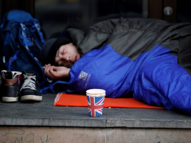 A homeless person lays in a sleeping bag on a pavement near Piccadilly Circus in central London on November 25, 2020. - Britain unveiled billions of pounds in state spending Wednesday despite soaring debt, including pay rises for nurses to support the virus-ravaged economy as the nation embarks on its …