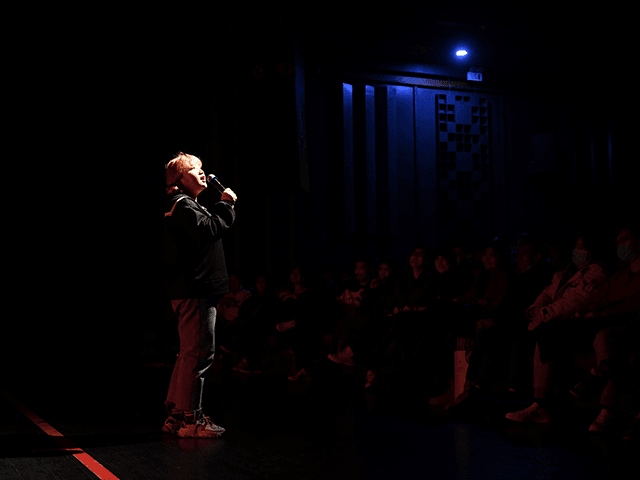 This photo taken on November 21, 2020 shows stand-up comedian Qiqi performing at a theatre in Beijing. - A new wave of young, female stand-up acts in China has crashed into what has always previously been a man's world, and benefiting from a surge of interest in stand-up in China …