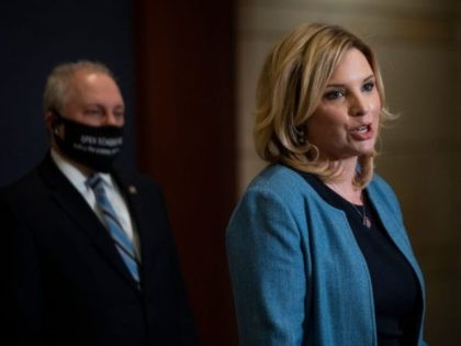 US Representative Ashley Hinson (R-IA) speaks as Steve Scalise (R-LA)looks on during a House Republican press conference on Capitol Hill in Washington, DC on March 9, 2021. (Photo by ANDREW CABALLERO-REYNOLDS / AFP) (Photo by ANDREW CABALLERO-REYNOLDS/AFP via Getty Images)