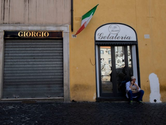A man talks on his mobile phone in front of a closed shop in central Rome on March 15, 2021, after most of Italy re-entered into lockdown restrictions aimed at curbing the spread of the Covid-19 (novel coronavirus) pandemic. - Italy's government on March 12 announced tough new restrictions for …