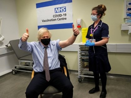 Britain's Prime Minister Boris Johnson reacts after he received a dose of a AstraZeneca/Oxford Covid-19 vaccine, administered by nurse and Clinical Pod Lead, Lily Harrington, at the vaccination centre in St Thomas' Hospital in London on March 19, 2021. - British Prime Minister Boris Johnson said on Wednesday he will …