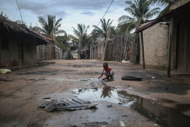 TOPSHOT - A child plays in one of the alleys of the port of Paquitequete near Pemba on March 29, 2021. Sailing boats are expected to arrive with people displaced from the coasts of Palma and Afungi after suffering attacks by armed groups since last March 24. - Dozens of …